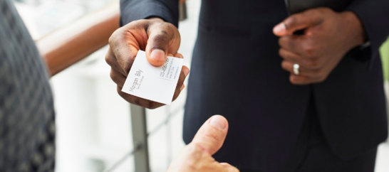 a man passing business card